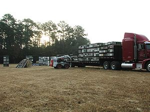 US migratory beekeepers loading tractor-traile...